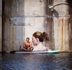 NYC-based Sean Yoro aka Hula on his paddle board with his work in Hawaii, 5/15 (LP)