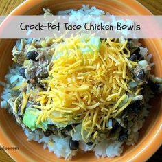 Crock-Pot Taco Chicken Bowls Recipe Main Dishes with chicken, salsa, black beans, frozen corn, chili powder, cumin, garlic powder, cayenne pepper, salt, pepper, rice, shredded cheddar cheese