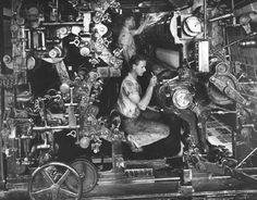 Working inside a printing press at RR Donnely and Sons, printers of the Montgomery Ward Catalog, 1942, Chicago. Torkel Korling.