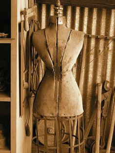 "This Ivy House. Dressform with ""wasp"" waist"