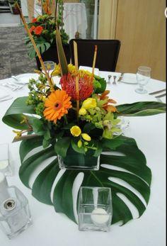 colourful flower arangement on a palm leaf