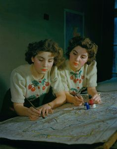 1944 - Twins Rita and Irene Day at work in the map section of the Ministry of Town and Country Planning, December 1944. (Photo by Popperfoto/Getty Images)