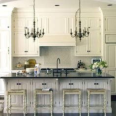 white kitchen, love the chandeliers over the island from Southern Living Kitchen