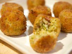 Risotto Croquettes: Arancini Di Riso...leftover risotto, mozarrela, and ham filled fried deliciousness!