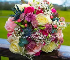 Gorgeous bouquet with roses, thistles and berries
