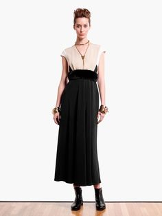MaxMara pure silk tricolour maxi dress is worn with black leather ankle boots. Accessorise MaxMara logo charm gold-tone bangle sets.  Prices on request.