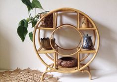 Vintage bamboo shelf unit, unusual circular bohemian plant stand or shelves, display stand.  This is quite large and measures 63 cm tall by 57 long and 24 cm wide. There are six wicker shelf tops for displaying smaller plants, ornaments, pottery, herbs or toiletries. Its freestanding and not too heavy to carry.  The bamboo has lots of age and character, with some wear to the varnish, and two of the shelves have some rippling to the wicker but no stains or damage.  Its a really stunning piece…