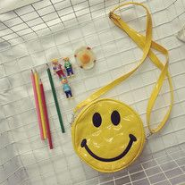 This is a very cute smiley face small size shoulder bag made of PU material. The size is big enough to fit wallet, mobile phone, and makeup.   • Brand new  • Size: about  - Measures: 16 x 4 cm