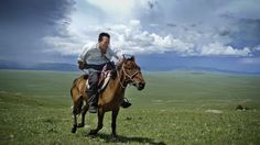 National Geographic 125 Years    Mongolia, 2009. Research scientist and National Geographic Emerging Explorer Albert Lin gallops across the steppes of northern Mongolia as he searches for Genghis Khan's tomb and other archaeological sites. (Photo by Mike Hennig via National Geographic)