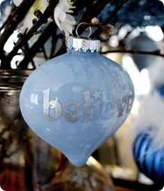 Handmade ornaments - clear glass, swirl thinned paint inside, decorate with adhesive letters.