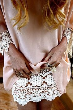 I love the touch of lace under a simple pink shift dress. Do you think it's just trim, or a slip?