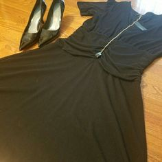 The Perfect little black dress! Great comfortable black dress! Rouching in the middle to give a flattering look. Perfect for work, wedding or a graduation. Never been worn but looks and fits great! Please feel free to ask me questions! The Limited Dresses