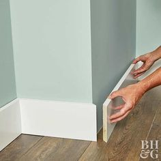 Baseboard molding provides a visual and physical connection between walls and adjacent flooring, door and window casings, and a home& architectural style We share everything you need to know when choosing and installing baseboard trim - diy-home- Baseboard Styles, Baseboard Molding, Floor Molding, Moldings And Trim, Baseboard Ideas, Moulding, Crown Molding, Wainscoting, Bathroom Baseboard