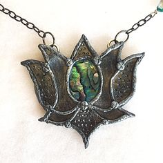 A personal favorite from my Etsy shop https://www.etsy.com/listing/508420649/blue-abalone-shell-healing-lotus-flower