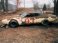 Barn find, you say? Yep, if you consider an old historic race car sitting outside to rot a barn find, then we have another tale to tell. This time it's about a 1969 Dodge Daytona NASCAR that … Dodge Daytona, Daytona 500, Nascar Race Cars, Old Race Cars, Supercars, 1969 Dodge Charger, Rusty Cars, Roadster, Abandoned Cars