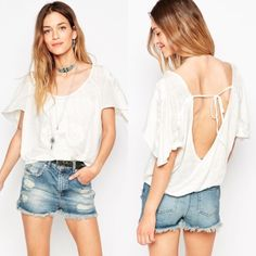 •NWT• Free People White Embroidered Top NWT and never worn flowy top with embroidery detail and a flutter sleeve. Elastic waistband allows for blouson styling. Low scoop back with tie. 100% linen. Free People Tops Blouses