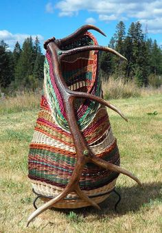 Elk Antler Basket Woven with willow, artist dyed rattan, sisal, sea grass, copper wire and beads by Montana Blue Heron