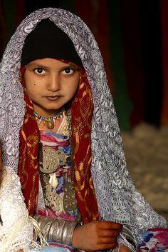 Veiled Tuareg girl with jewels in Ghadames, Libya