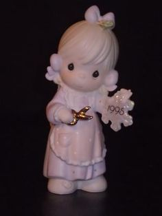 "1995 Precious Moments Figurine ""He Covers The Earth With His Beauty"" #142654"