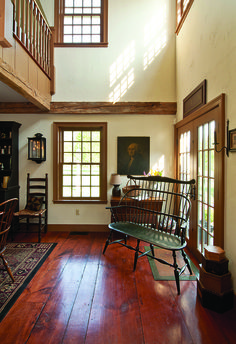 Love the stained windows and wood with light walls. The outside coming in will be the color. windows, hand-stained wide-plank flooring, and barn beams are featured throughout the home. Colonial Home Decor, Colonial Furniture, Country Furniture, Country Decor, Colonial Decorating, Colonial Chair, Colonial Kitchen, Country Homes, Rustic Decor