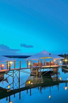 The five lantern-lit pontoons of the romantic Barachois restaurant float above the lagoon. Constance Le Prince Maurice (Mauritius) - Jetsetter