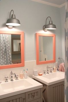 Bathroom Lights - wonder if they come in bronze/copper?  Barn Lights from Lowes, $39.98 over bathroom vanity