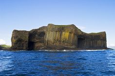 Fingal's Cave on the island of Staffa in Scotland | Although it may seem like this block structure is man-made, it was actually formed by hexagonally jointed basalt columns within a Paleocene lava flow.
