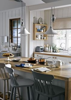 Carradale kitchen; Selby ceramic rise and fall ceiling pendant and Cecile bar chair, both from the Croft collection, John Lewis