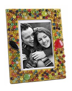 This beautiful handcrafted photo frame with colorful beads work at the border to give it an artistically new dimension. Patterned lac work at the edges make these photo frames look ethnic and elegant. Photo frames that cherish your loving moments with beauty and care.