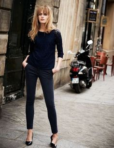 Navy boxy sweater with charcoal ankle trousers and pointed flats