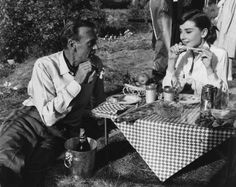 Audrey Hepburn & Gary Cooper sharing a picnic... Now this is one picnic that I would enjoy.