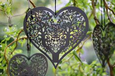 Grey cutout hanging heart decorations for the ceremony