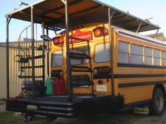 Looks like spiral staircase leads to from back porch to upper deck on this school bus camper! School Bus Tiny House, School Bus House, Motorhome, Converted School Bus, Bus Living, Tiny Living, Kombi Home, Short Bus, School Bus Conversion