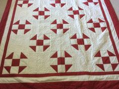 Shoe Fly quilt made by Sharon Theriault.  Quilted with red thread