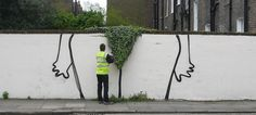 """This suggestive topiary street art installation called """"Bush"""" appeared in Canonbury, London and is is one of the newest works by Banksy."""