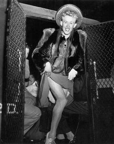 Cross-dresser 1940's getting out of the paddy wagon by Weegee street/crime photographer  (please follow minkshmink on pinterest)