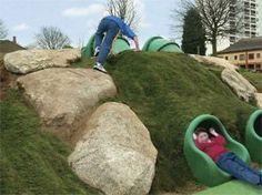 Natural Play scape. kids slide in a hill. slides for kids.