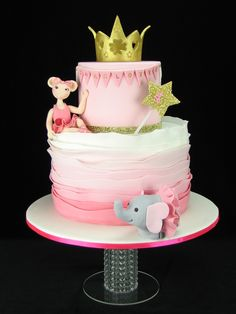 Charlotte had many favourite things she wanted included in her birthday cake but we settled on including pink, sparkle, Angelina Ballerina and her toy elephant Ellie and a gold crown and wand. Inside this pretty ruffle cake are pink ombre layers of vanilla sponge with a column of pink chocolate beanies hiding in the middle. The top tier is a dummy cake. — at Airodrome Trampoline Park Geelong.