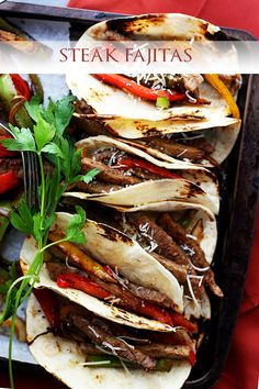 Steak Fajitas - Perfectly seasoned, classic steak fajitas with onions and peppers, wrapped in warm flour tortillas.