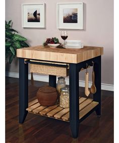 A stunning contrast of black and natural wood creates a highly sophisticated, chic look for the Color Story Antique Black Butcher Block Kitchen Island. This butcher block can handle all the pounding, chopping and slicing you can.