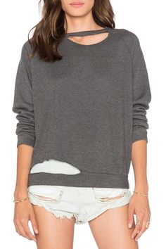 Front cut-out detail.Charcoal colour sweatshirt.You can complete the look with jeans and accessorize with bangles and rings.   Distressed Sweatshirt  by LNA. Clothing - Sweaters - Sweatshirts & Hoodies Toronto, Canada