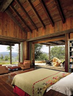 This beautifully rustic master bedroom has the best of views. | architecturaldigest.com Design by Backen, Gillam & Kroeger Architects Photo by Erhard Pfeiffer
