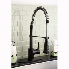 Create a utilitarian kitchen with this Concord modern spiral pull-down kitchen faucet. This swiveling faucet features an oil rubbed bronze finish and pull-down sprayer.