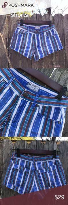 """Free People Striped Shorts Free People mid rise striped shorts. Stripes are blue, white, brown, and teal green. Colors are a bit faded from regular wash and wear. Classic five pocket design. Ladies size 24. Inseam is 2.5"""". Rise is 9"""". Gently worn. Free People Shorts Jean Shorts"""