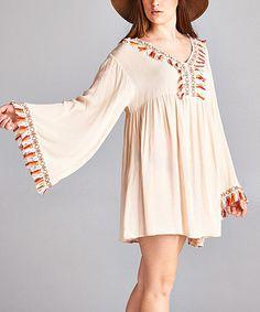 Look at this #zulilyfind! Beige Tassel Bell-Sleeve Tunic - Plus #zulilyfinds