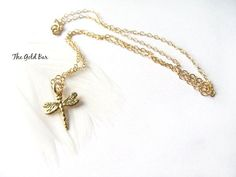 Inspired by nature. This Gold Dragonfly Necklace features an intricate dragonfly charm in gold vermeil which floats from a fine cable chain in 14K gold fill. Available in a range of chain lengths; this delicate gold necklace will be handcrafted just for you. Available to buy today at TheGoldBar.etsy.com  #Dragonfly Necklace #Gold Dragonfly Necklace - #DelicateGoldNecklace - #TheGoldBar