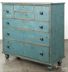 New England or Canadian painted butternut chest of drawers, 19th c., retaining a later blue surface, 47 1/4'' h., 47 1/4'' w.