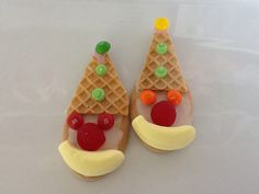 Clown biscuits. Made with milk arrowroot, thin ice cream wafers cut into a triangle, and lollies to decorate.