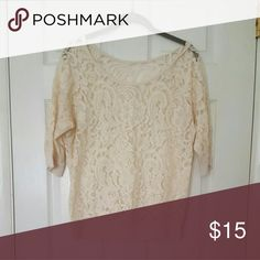 Sheer lace top Scoop neck sheer lace top, 3/4 sleeves. Tags were removed because they were itchy. I normally washed it in a lingerie bag on cold and hung to dry. Jr size large Beige -good condition Tops Blouses