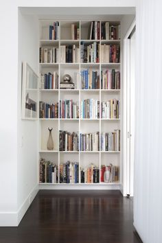 One day, I will have a home with a bookshelf like this. I'll need a ladder though :)